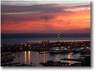 Fotografie Genova - Panorami - Genoa: harbor at sunset